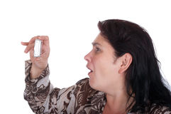 The woman emotionally photographs the camera. On a white background Stock Photo