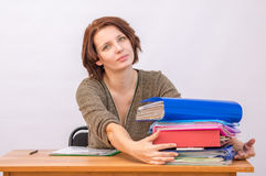Woman employee anxiously pulls to his stack. Of folders Stock Images