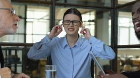 Woman employee closing ears, tired of office conflicts, emotional instability. Stock footage stock video