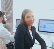 Woman employee and colleague sitting at the Desk Stock Photo