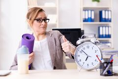 The woman employee going to sports from work during lunch break. Woman employee going to sports from work during lunch break Royalty Free Stock Photo