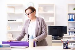 The woman employee going to sports from work during lunch break. Woman employee going to sports from work during lunch break Royalty Free Stock Photography