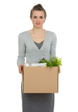 Woman employee holding box with personal items Royalty Free Stock Images