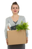 Woman employee holding box with personal items Stock Photography