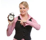Woman employee pointing on alarm clock Stock Photography