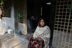 Woman Empowerment. Safira bibi doing little business from her home with the help of  Micro Finance project of Bandhan.Bandhan (meaning togetherness) was born in Royalty Free Stock Images