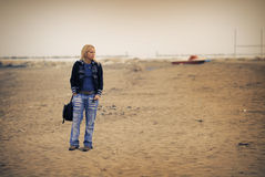 Woman on empty beach Royalty Free Stock Photography