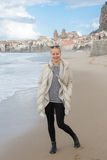 Woman on empty beach of Cefalu in winter time, Sicily, south Italy. Stock Photography