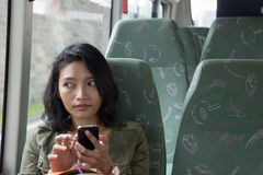 Woman in the empty bus Royalty Free Stock Photo
