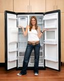 Woman with an empty fridge Royalty Free Stock Images