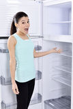 woman and empty fridge Royalty Free Stock Images