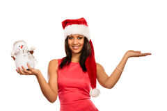 Woman with empty hand in santa hat holds snowman. Stock Images