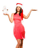 Woman with empty hand in santa hat holds snowman. Royalty Free Stock Photos