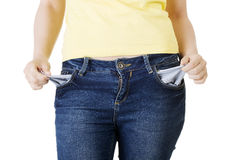 Woman with empty pockets Royalty Free Stock Image