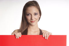 Woman with empty poster Royalty Free Stock Photos