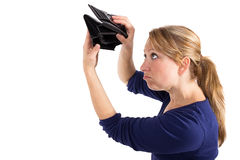 Woman with an empty purse. Woman looking sad at an empty wallet Stock Image