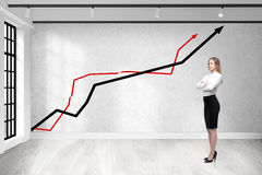 Woman in empty room with graphs stock photo