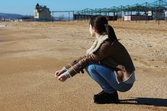 Woman on empty sandy beach Stock Images