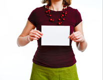Woman with empty sheet. Of paper in hands, on plain white background Royalty Free Stock Photo