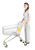 Woman with empty shopping cart Royalty Free Stock Photography