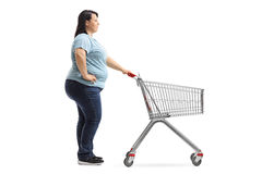 Woman with empty shopping cart waiting in line Royalty Free Stock Photo