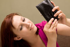 Woman with empty wallet royalty free stock image