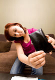 Woman with empty wallet Royalty Free Stock Images