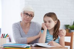 Woman encouraging young girl Royalty Free Stock Photo