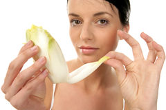 Woman with endive Stock Photography