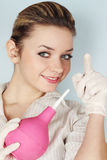 Woman with the enema. Indicates by the finger Stock Photos