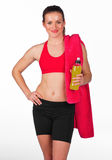 Woman with energy drink bottle. Attractive woman in fitness clothes with energy drink bottle Royalty Free Stock Photography