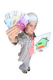 Woman with energy panel Stock Photo