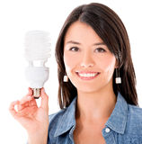 Woman with an energy saving bulb Stock Photo