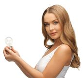 Woman with energy saving bulb Royalty Free Stock Photography
