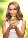 Woman with energy saving bulb Stock Photos