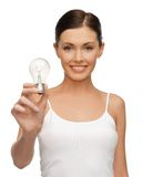 Woman with energy saving bulb Royalty Free Stock Image