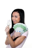 Woman with energy-saving lamp. Energy lamp and money Stock Images