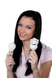 Woman with energy-saving lamp. Energy lamp. Young woman with energy-saving lamp. Energy lamp and bulb Royalty Free Stock Photography