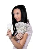 Woman with energy-saving lamp. Energy lamp. And dollar bills Royalty Free Stock Photo