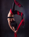 The woman is engaged in aerial acrobatics. Stock Photography