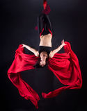 The woman is engaged in aerial acrobatics. Royalty Free Stock Photo