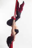 The woman is engaged in aerial acrobatics. Royalty Free Stock Image
