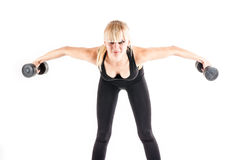 Woman is engaged with dumbbells Stock Photos