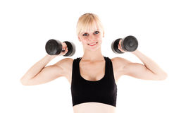 Woman is engaged with dumbbells Royalty Free Stock Photos
