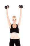 Woman is engaged with dumbbells Stock Image