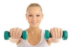 Woman engaged in fitness dumbbells Royalty Free Stock Photo