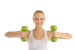 Woman engaged in fitness dumbbells from apples. Isolated on white Stock Photography
