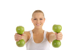 Woman engaged in fitness dumbbells from apples Royalty Free Stock Photography