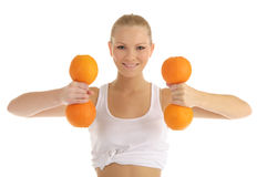 Woman engaged in fitness dumbbells of oranges Royalty Free Stock Photos