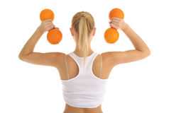 Woman engaged in fitness dumbbells of oranges Royalty Free Stock Images